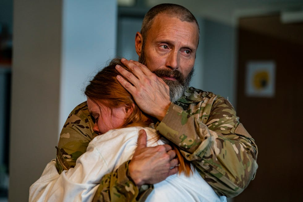 """Marcus (Mads Mikkelsen) consoles his daughter Mathilde (Andrea Heck Gadiberg) after her mother's tragic death.  Marcus becomes convinced that the death of his wife was not an accident and seeks revenge on him """"Knights of Justice."""""""