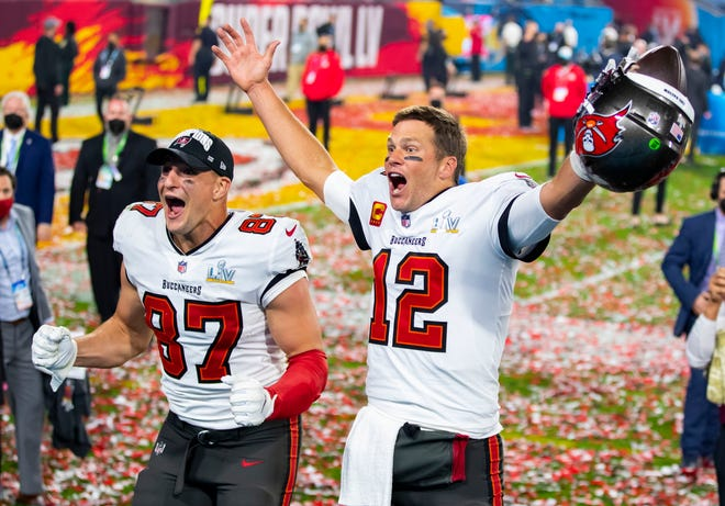 Tampa Bay Buccaneers quarterback Tom Brady (12) and tight end Rob Gronkowski (87) celebrate after beating the Kansas City Chiefs in Super Bowl LV at Raymond James Stadium.