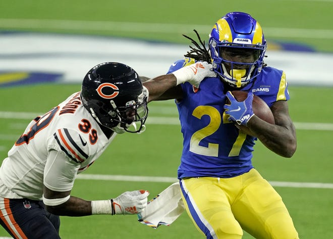 Los Angeles Rams running back Darrell Henderson (27) carries the ball as Chicago Bears defensive end Roy Robertson-Harris (95) makes the tackle during the second half at SoFi Stadium.