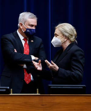 Rep. James Comer, R-Ky., talks with Chairwoman Carolyn Maloney, D-N.Y., during a House Oversight and Reform Committee hearing May 12 on the attack on the U.S. Capitol in January.