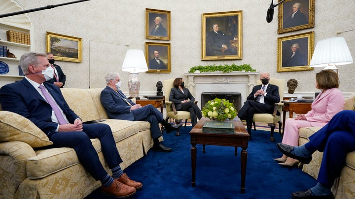 President Joe Biden speaks during a meeting with congressional leaders in the Oval Office of the White House, Wednesday, May 12, 2021, in Washington. From left, House Minority Leader Kevin McCarthy of Calif., Senate Minority Leader Mitch McConnell of Ky., Vice President Kamala, Biden, House Speaker Nancy Pelosi of Calif., and Senate Majority Leader Chuck Schumer of N.Y.
