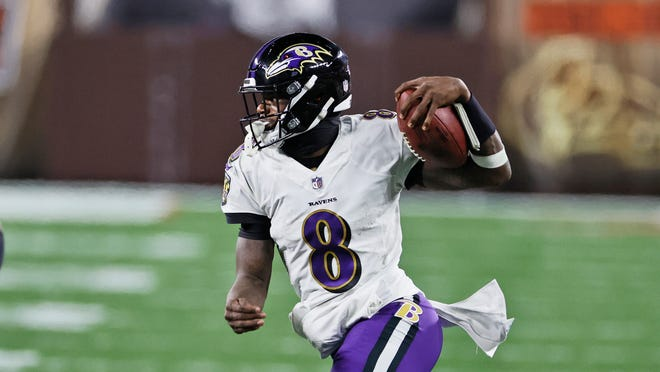 Baltimore Ravens quarterback Lamar Jackson scrambles during the second half of an NFL football game against the Cleveland Browns.