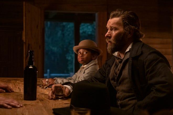 "Chase W. Dillon as Homer and Joel Edgerton as Ridgeway on ""The Underground Railroad."""