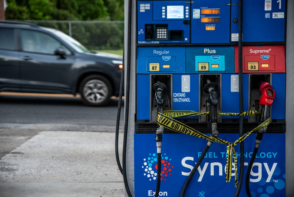 Caution tape is wrapped around fuel pumps at an Exxon Gas Station on Boonsboro Road in Lynchburg, Va., May 11, 2021. More than 1,000 gas stations in the Southeast reported running out of fuel, primarily because of what analysts say is unwarranted panic-buying among drivers, as the shutdown of a major pipeline by hackers entered its fifth day. In response, Virginia Gov. Ralph Northam declared a state of emergency.