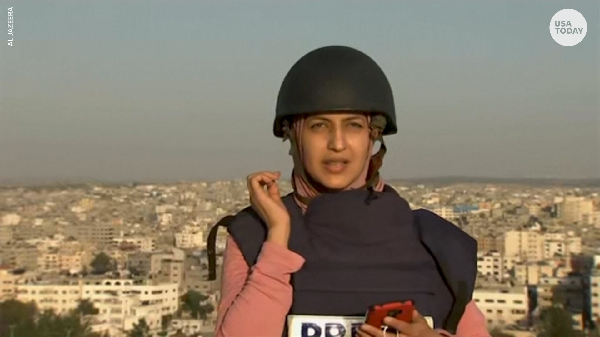 Journalist shaken when airstrike hits building directly in front of her during live report