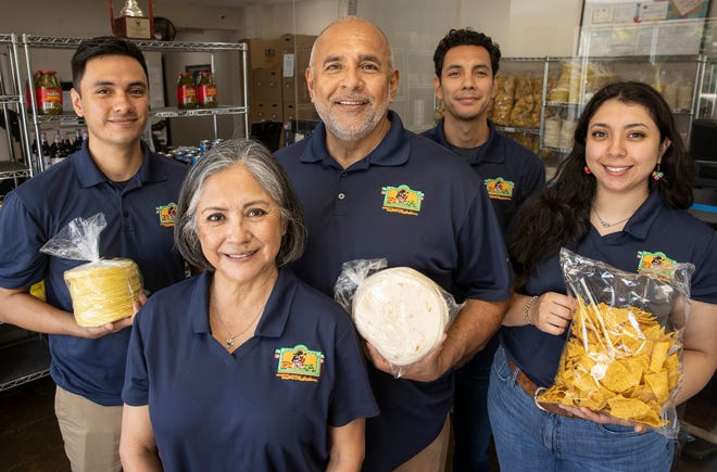 Elvira and Jaime Picos are the founders and owners of Fiesta Tortillas. Their children, from left, Luis Picos, A.J. Picos and Natalia Picos, are involved in the family business.