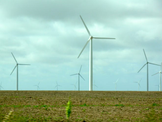 Wind turbines work to make power near Lubbock. [AMERICAN-STATESMAN/FILE]