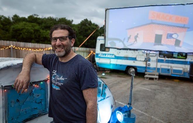 Josh Frank, owner of Blue Starlite Mini Urban Drive-In, poses for a portrait on Friday, April 30, 2021, before a three-screen showing in Austin, Texas.