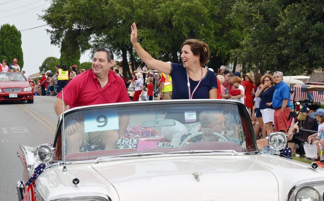 Mayor Sandy Cox waves to the crowd during Lakeway's Fourth of July parade in 2018.