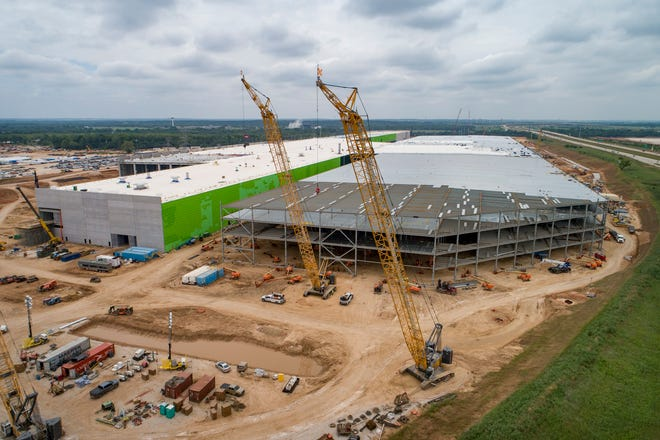 Construction continues at the Tesla Gigafactory in southeastern Travis County last month. CEO Elon Musk announced in July 2020 that the company would build its newest $1.1 billion manufacturing facility here. It's one of a number of big pandemic-era wins for Austin's tech sector.