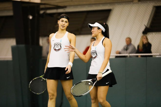 Georgia tennis player Marta Gonzalez & Georgia tennis player Elena Christofi during a match against Michigan State in the Lindsey Hopkins Indoor Center in Athens, Ga., on Sat., Jan. 25, 2020. (Photo by Tony Walsh)