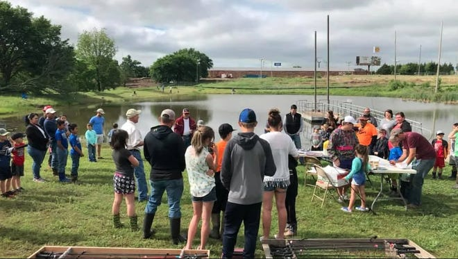 Children and families enjoying the 2019 Kid's Fishing Derby at Regional Park.