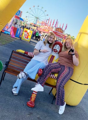 Nina Steiner attends the Columbia County Fair with her new best friend Sam Lewis, whom she met while attending Grovetown High School as a foreign exchange student.
