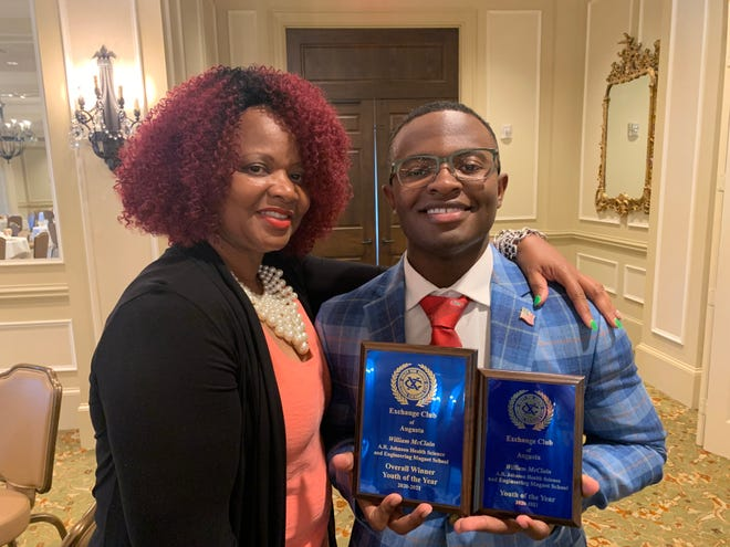 William McClain, seen with his mother, Valerie Frasher, was selected by the Augusta Exchange Club as the Youth of the Year.