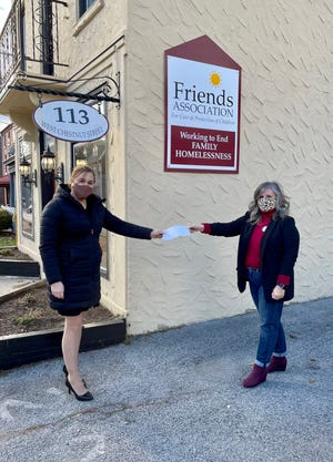 Amy Brooks, of Wisler Pearlstine, presents a check to Jennifer Lopez, executive director of the Friends Association for the Care and Protection of Children.