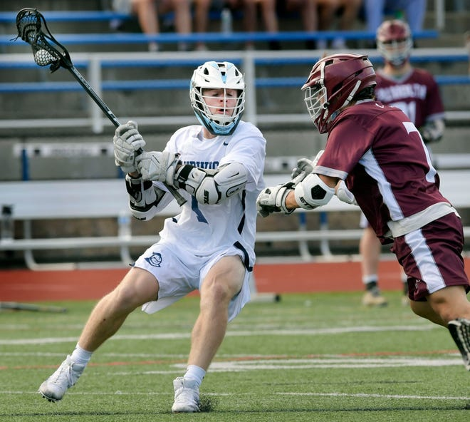 Aidan Rodgers of Sandwich turns on Aaron Schlezinger of Falmouth Thursday. Rodgers, along with Avery Richardson, recorded a hat trick against the Clippers in their 13-4 win in Sandwich.