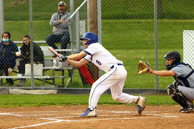 PY's # 8 Mason MacKerchar squares around to bunt and make contact with the incoming pitch.