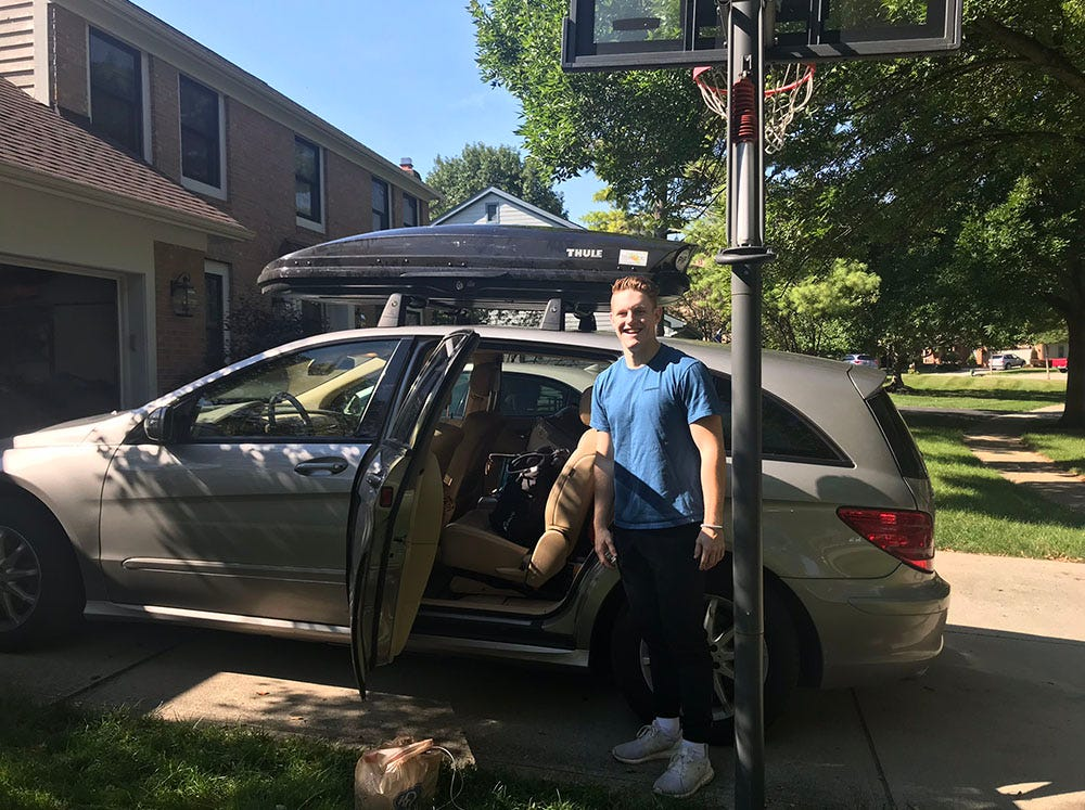 Collin Wiant stands next to the family's car in Dublin the morning of move-in day at Ohio University in August 2018.