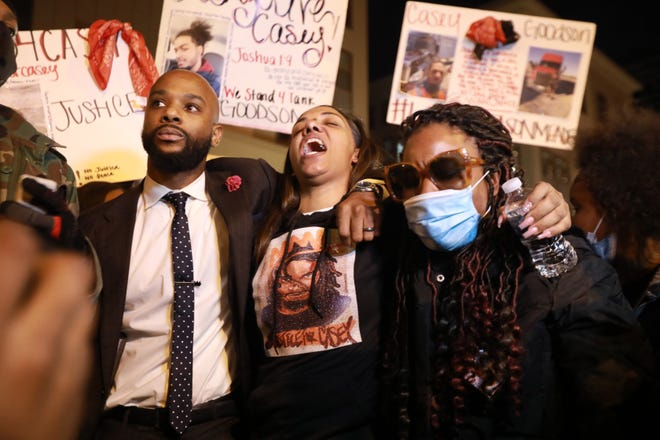 Tamala Payne (center), with attorney Sean Walton, and Jamita Malone speak at a protest march after the shooting of Payne's son, Casey Goodson Jr., by a Franklin County deputy sheriff during a Columbus, Ohio. Jamita Malone is the mother of Julius Tate. Tate set up fake online ads with the intent to rob those who responded and Police set up a sting operation after other such robberies and Tate pulled a gun on an undercover officer during the incident, leading a SWAT officer to fatally shoot him. The downtown protest was held Friday, December 11, 2020. About 400 people marched in his honor.