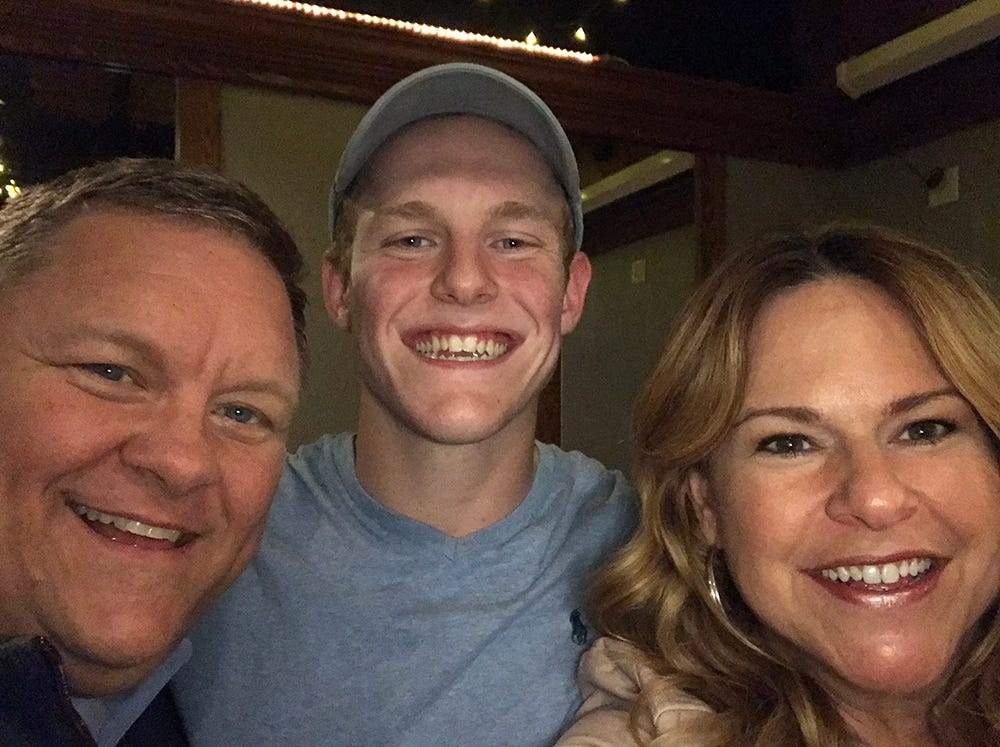 Collin with his parents, Kathleen and Wade.