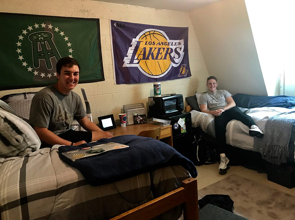 Collin (right) and his roommate, Alex Porchinsky, pose together in their Ohio University dorm room on move-in day.