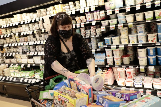 Grocery stores and other retailers may continue to require masks after the state's requirement ends June 2. This photo shows Sarah Guinther shopping at a Giant Eagle in Clintonville last year.