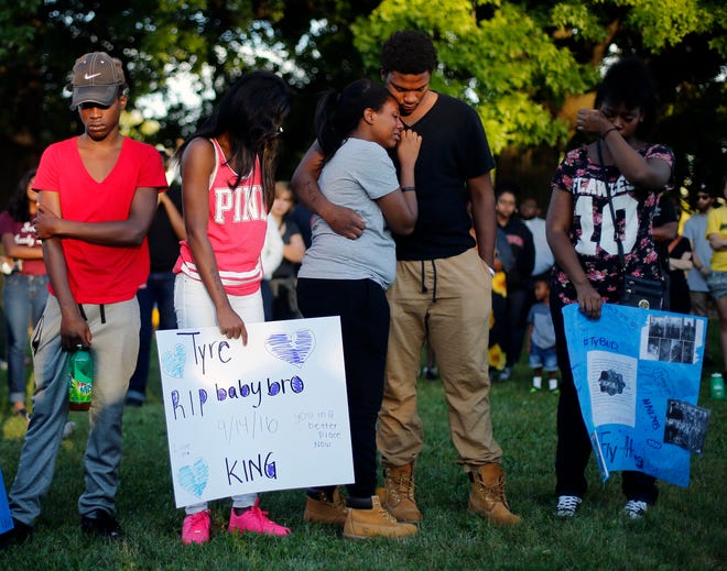 Family and friends of 13-year-old Tyre King comfort each other during a 2016 vigil for the boy the day after King was fatally shot by a Columbus police officer.