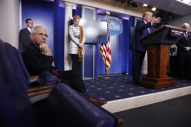 Dr. Anthony Fauci, then director of the National Institute of Allergy and Infectious Diseases, left, listens as President Donald Trump speaks during a coronavirus task force briefing at the White House on April 5, 2020, in Washington. From left, Fauci, Dr. Deborah Birx, White House coronavirus response coordinator, Trump and Vice President Mike Pence.