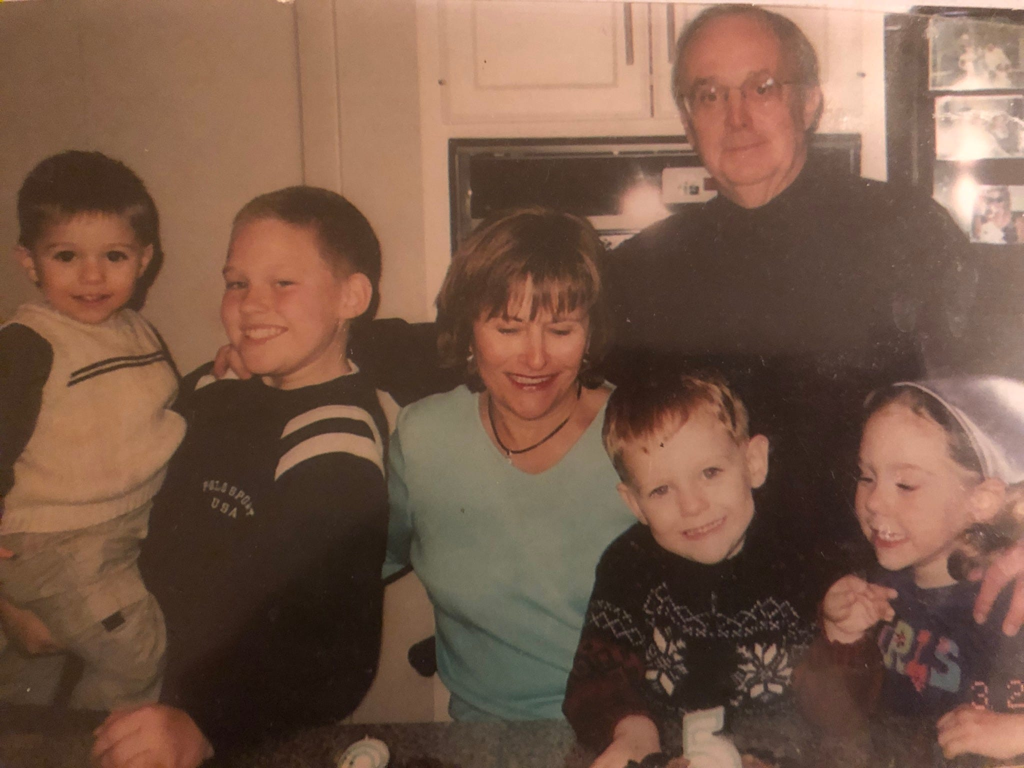 Aidan, Austin, Kathleen's parents Mary Jane and Michael, Collin and Olivia gathered in the family's kitchen in the early 2000s.