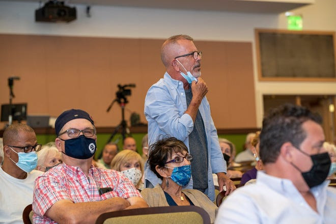 A community member proposes a question at the Mount Dora town hall meeting. [Cindy Peterson/Correspondent]