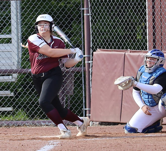 John Glenn freshman Sydney Marshall (18) connects for a second inning home run in Division II sectional tournament action with East Liverpool at John Glenn High School Wednesday evening.