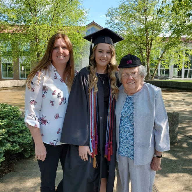 """Three generations of Muskingum graduates are, l to r, Christine """"Chris"""" Dobbins (Class 1993); Cassidy Dobbins (Class of 2021) and Doris George (Class of 1955), who wears the beanie she received from the university in New Concord. The three women all obtained early childhood education degrees."""