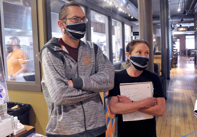 Matthew McBride, Spoon Market and Deli general manager, and Jordan Smith, owner, are conflicted over lifting the mask mandate citing potential customer concerns.