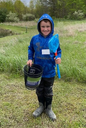 Corbin Eikleberry, 8, of Loudonville, shows off his prizes for catching the first fish of the second session at the May 8 Family Fishing Day hosted by the Ashland County Soil & Water Conservation District. The event was held at Ashland County Parks' Byers Woods.