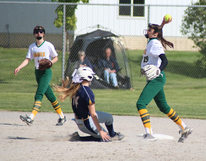 Sand Creek second baseman Tanana Emmendorfer (29) forces out Whiteford's Berlynn Keller (14) while trying to turn a double play during the seventh inning of game one of their TCC doubleheader Wednesday at Sand Creek.