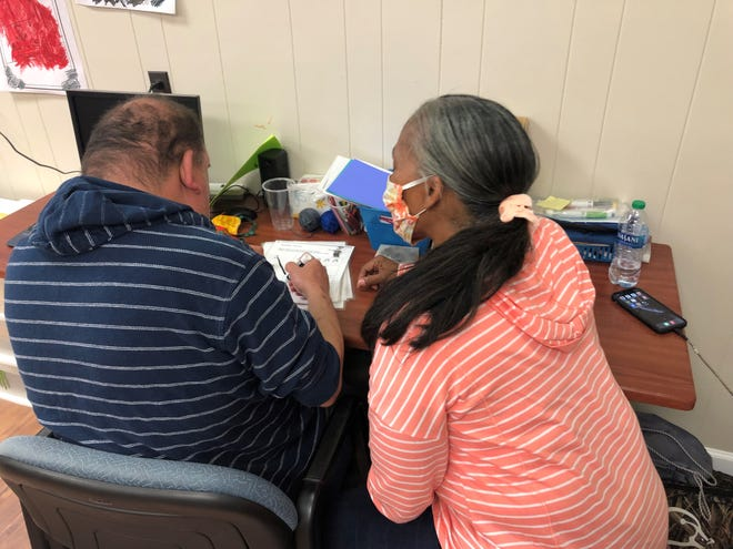 Loistene Johnson used her recent training as a Direct Support Professional to take the time to listen to one of the people with developmental disabilities she serves as an employee of Arc of Davidson County