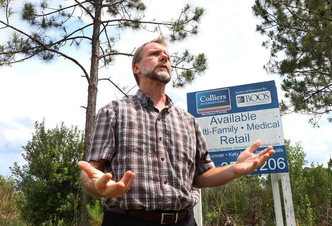 Volusia County Chairman Jeff Brower stands in front of a comercial property site on LPGA Blvd., Wednesday May 12, 2021 while talking about overdevelepment to the area.
