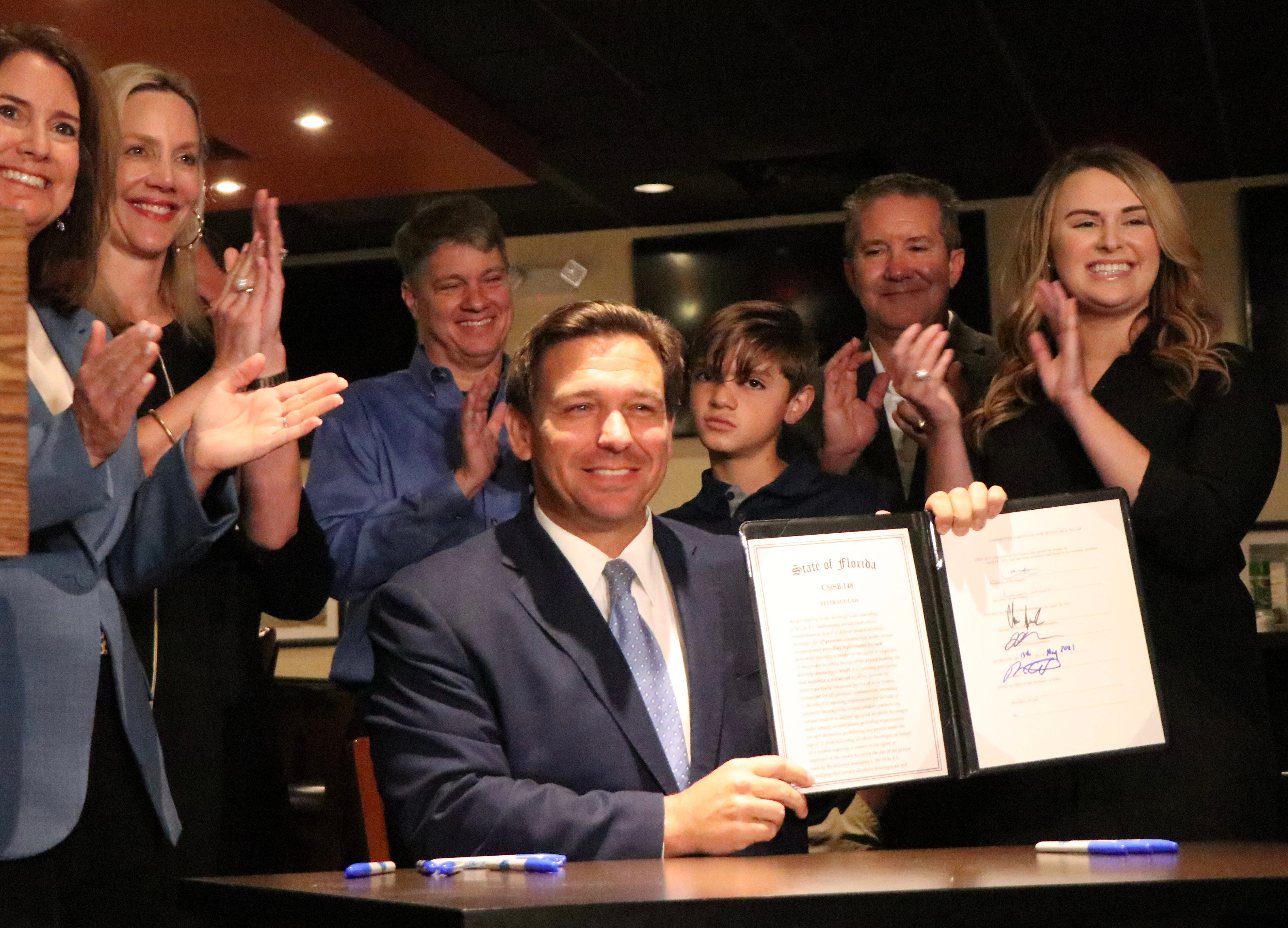 Cheers! DeSantis signs drinks-to-go bill at Houligan's in Ormond Beach 3