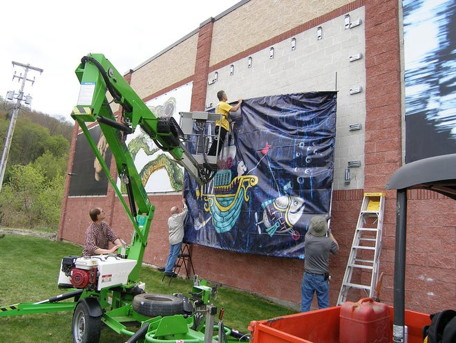 Shown is the installation of the Great Wall of Honesdale.
