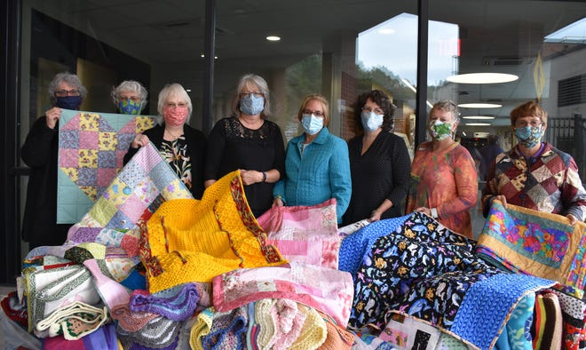 """Project Linus Wayne County Chapter was among the non-profit entities receiving a grant from WMHF in 2020. Shown, left to right, are """"blanketeers"""" Cathy Lewis, Deb Jacobson, Gail Kmieczak, Patty May, Holly Hubert, Amy Harris, Deb Fulmer, and Sharon Herzog."""