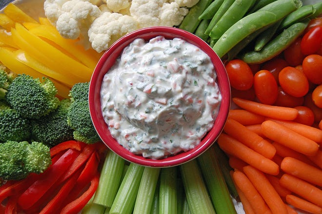 This dip combines dairy with various chopped vegetables.