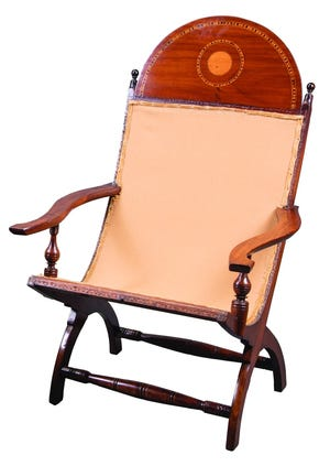 These Campeche chairs are made of mahogany with a small, circular inlay of a lighter wood. They were estimated to be worth $5,000 each.