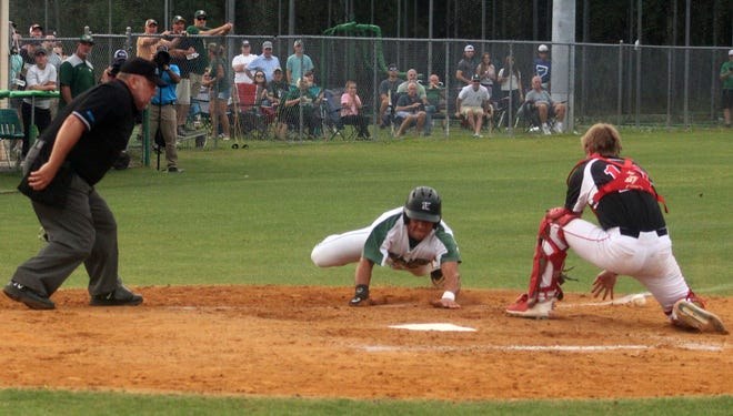 Fleming Island right fielder Angelo Scionti slides around the tag of Creekside catcher Bryce Brindle for a first-inning run in the FHSAA Region 1-6A baseball semifinal.