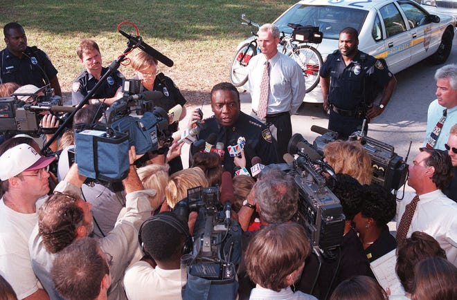 Nat Glover, then sheriff of Jacksonville, conducts a 1998 news conference near where the body of 8-year-old Maddie Clifton was found in a neighbor's home.