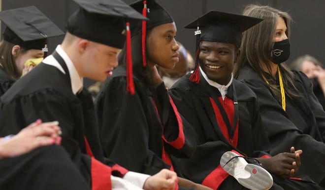 Graduating senior Solomon Isaiah Ponder smiles as he looks at his fellow classmates during the North Shelby graduation ceremony held Thursday morning, May 13, 2021.