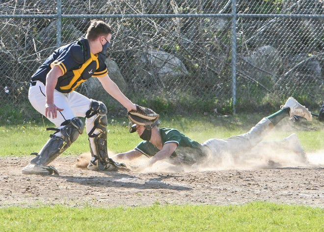 Oakmont's Watson Mexico slides into home with the go-ahead run while scoring on a sacrifice fly by Isaiah Smith during the sixth inning of the Spartans' 3-1 win over the Littleton Tigers, Wednesday, in Ashburnham.