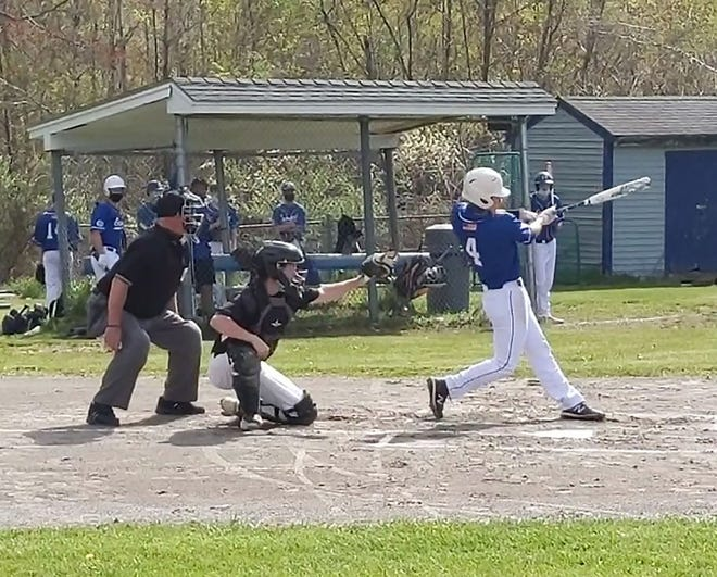Narragansett's Andrew Capps grounds a base hit through the left side of the infield during Wednesday's game against Maynard in Baldwinville.