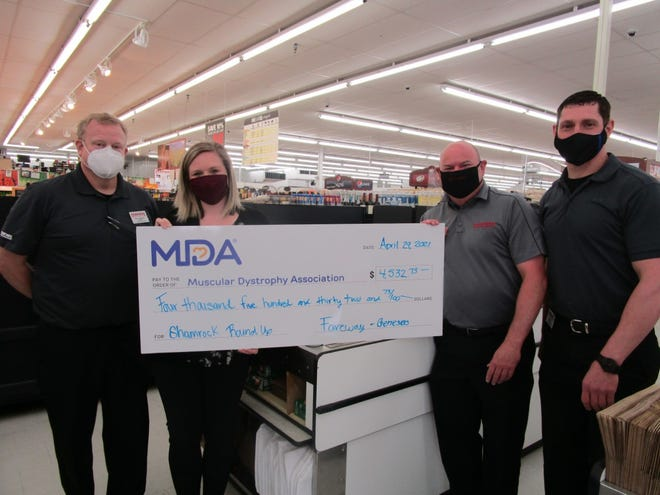 Bill Lanphere, left, general manager of Geneseo Fareway; Jillian Harper, national manager, Consumer Engagement & Cause Partnerships; Eric Klatt, assistant store manager; and Stan Melchert, meat manager, are shown at the check presentation from Fareway to the Muscular Dystrophy Association. The Geneseo Fareway raised $4,532 for MDA