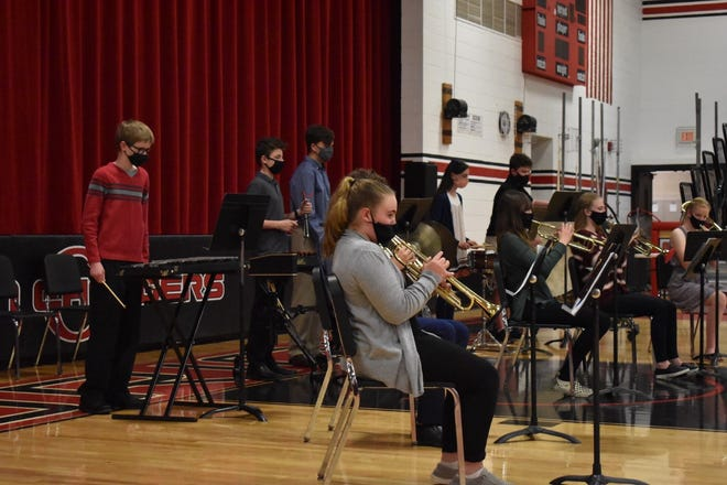 """Concert band plays """"Carpathia"""" for director Lauren Heiberger and a live audience on Wednesday, May 5, at Orion Middle School's Fine Arts Festival in the Orion High School gym"""
