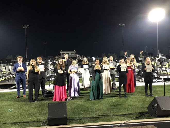 Geneseo District 228 annual All Unit Band Concert was held May 10 on the High School football field. Seniors in the band are shown with their awards.  Band director Steve Scherer was honored for his years as director.  He will be retiring this year.